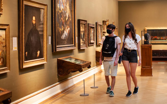 Two young visitors wearing masks in Ashmolean gallery