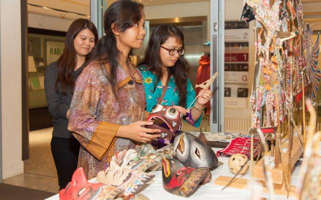 Three female visitors participating in Bali event