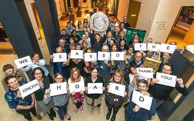 Ashmolean staff celebrating coin hoard fundraising success