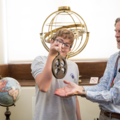 8.	Secondary Learning Officer Chris Parkin showing a Keystage 3 student how to use a mariner's astrolabe at the History of Science Museum. Image Oxford University Gardens, Libraries & Museums; credit Claire Williams.