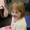 Child with painted face at Arts Award pilot activity session