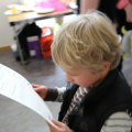 Child looking at his Arts Award Certificate at Arts Award pilot activity session