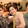 Three young boys taking part in Syrian family day at the Pitt Rivers Museum