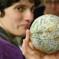 Woman holds a celestial globe