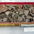 old stone tools in a mustard box