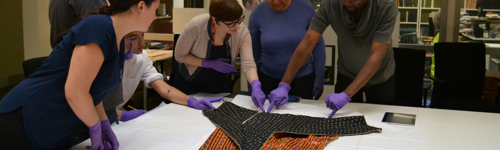 Researchers looking at collections