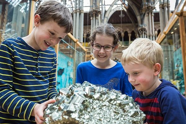 Children with pyrite at the Museum of Natural History