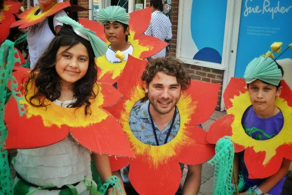 Group participating in family activity at Cowley Road Carnival