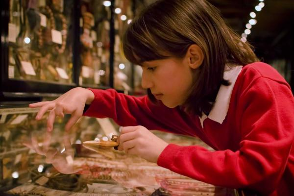 Student participating in education session at the Pitt Rivers Museum