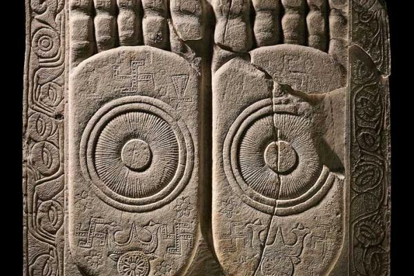 Foot of the Buddha, dome-slab sculpture carved on the front with Buddhapada (foootprints of the Buddha), each foot bearing a dharmacakra (wheel of the law) and lotuses