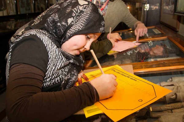 Young person taking part in community session in the museums
