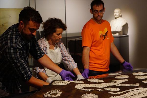 Ashmolean conservators working on Powhatan's Mantle, 2017