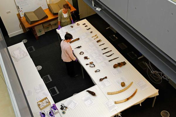 Two researchers with museum objects