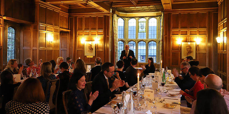 Dinner with long tables in a panelled room