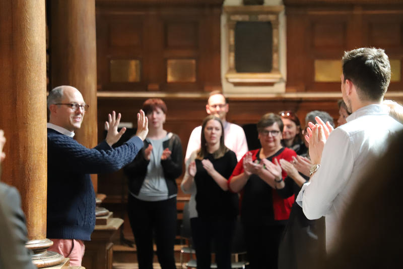 Adults clapping during Oxford Cultural Leaders session