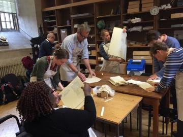Members of the public engaging in printing press activity at the Bodleian Libraries