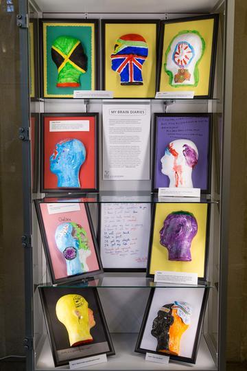 Display of nine painted heads