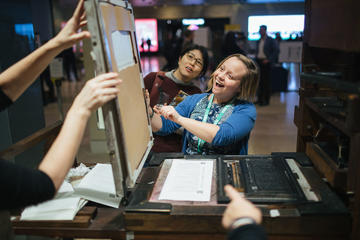 Participants enjoying the printing press
