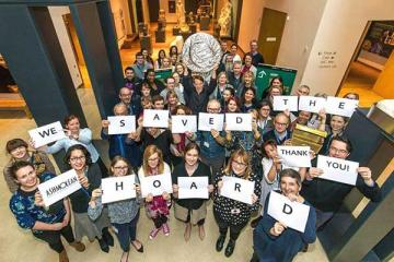 Ashmolean staff celebrating coin hoard fundraising success