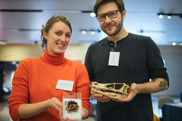 Two participants holding natural history specimens